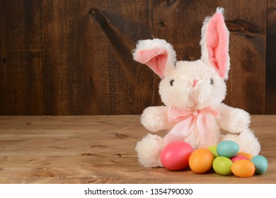 easter bunny with floppy ear and eggs
