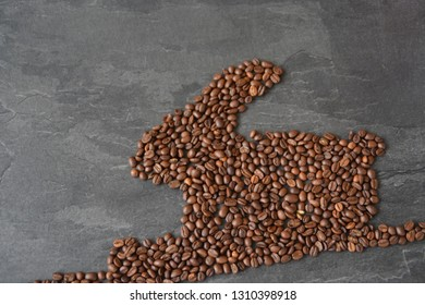 An Easter bunny made of freshly roasted coffee beans - concept for fresh coffee enjoyment on easter and as easter gift in the form of coffee beans