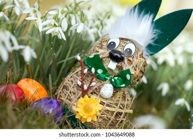 Easter bunny made of straw in nature