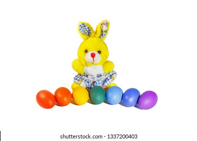 Easter bunny and painted eggs on a white background