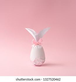 Easter bunny paper gift egg wrapping diy idea. Minimal easter pink concept.