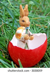 Easter bunny in a red egg shell with a mushroom in its hands