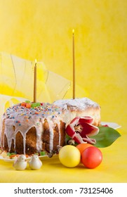 Easter cake with candles on a yellow background. Easter celebrating.