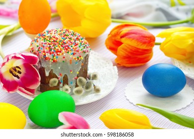 Easter cake and colored eggs.