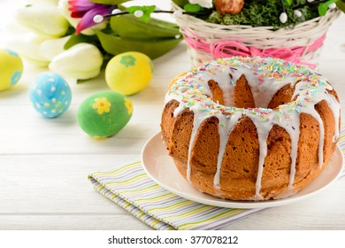 Easter cake and easter decorations on wooden table.