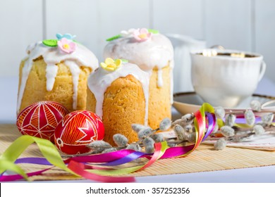 Easter cake and egg Pysanka on a white background