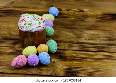 Easter cake and easter eggs on a wooden table