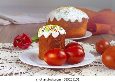 Easter cake and painted eggs on a table. Traditional orthodox christian easter food. Side view.