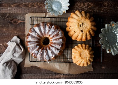 Easter cakes, brioche. Yeast cake with icing. A dark wooden table, cake forms.