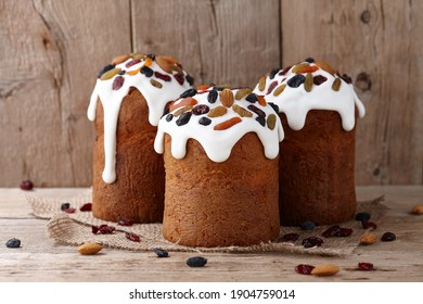 Easter cakes with candied fruits and nuts on wooden background