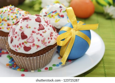 Easter cakes and easter egg on the white plate