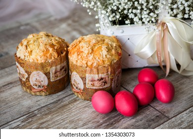 Easter cakes and painted eggs on wooden background,Decorated Easter cake and colorful eggs on festive Easter table. Sugar sprinkle dots, decoration for cake and bekery. Fresh delicious homemade easter