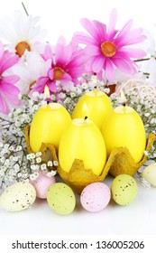 Easter candles with flowers close up