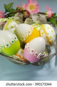 Easter candles in the shape of eggs , selective focus