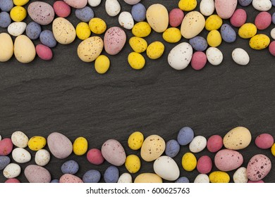 Easter candy chocolate eggs on a slate background