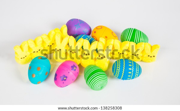 Easter Candy and decorated colorful eggs on a white background.