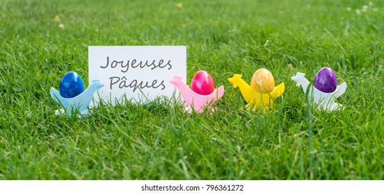 Easter card with colorful Easter eggs and french text: happy easter