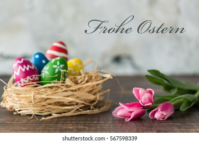 Easter card with decorated eggs and pink tulips/Easter card with decorated eggs/Happy Easter - Shutterstock ID 567598339