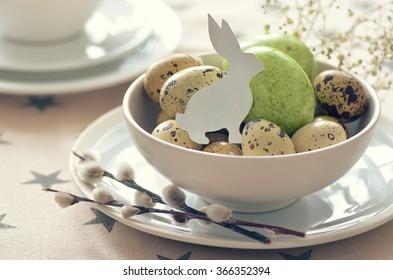 Easter celebration table setting, stylized photo