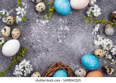 Easter chicken and quail eggs in blue color