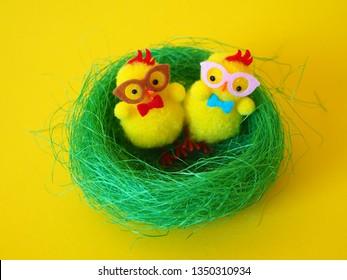 Easter chicks in green nest