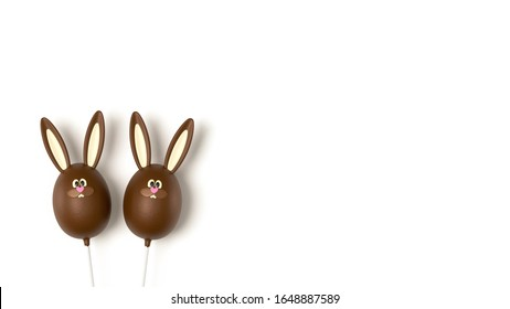 Easter chocolate eggs isolated on white background, top view. Sweet Easter stick candy, chocolate flavour, funny bunny egg. Rabbit bunny dessert, on white table, top view.