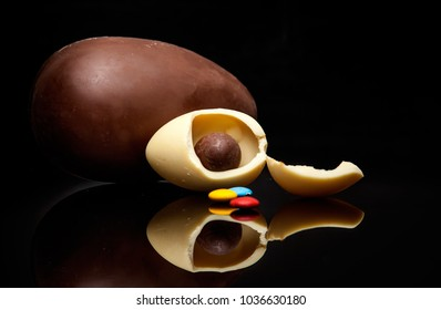 Easter chocolate eggs on a black background