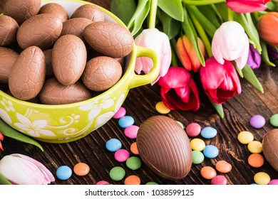 Easter chocolate rabbit,  eggs and tulips. Spring theme.