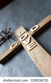 Easter christian wooden cross with an inscription god is love abstract religion background
