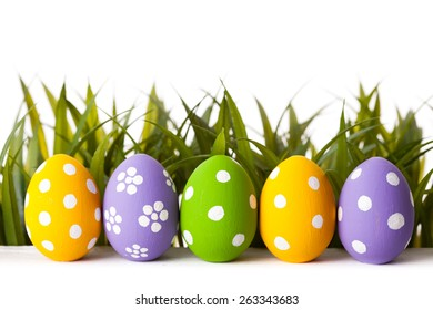 Easter colored eggs on the green grass. studio shot