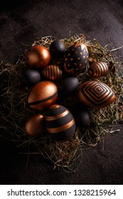 Easter composition with black and gold decorative Easter eggs