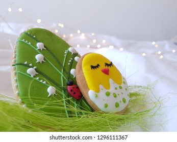 Easter composition, cake decorated with lily of the valley and ladybug on a light background