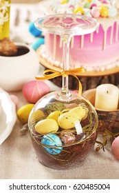 Easter composition with eggs inside glass goblet