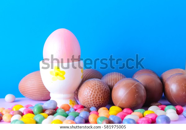 Easter composition with multicolored jelly beans and chocolate eggs