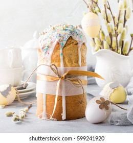 Easter composition with orthodox sweet bread, kulich and eggs on light background. Easter holidays breakfast concept.
