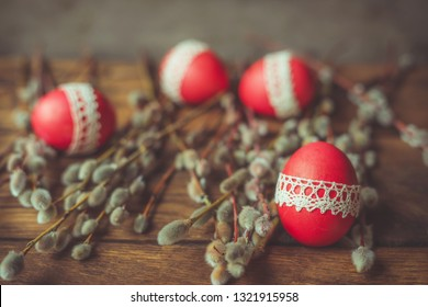 Easter composition of red Easter egg and willow branches.