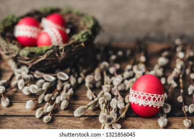 Easter composition of red painted eggs and willow branches.