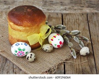 Easter composition of sweet bread, paska and eggs on wooden background. Orthodox kulich. Holidays breakfast concept with space for text.