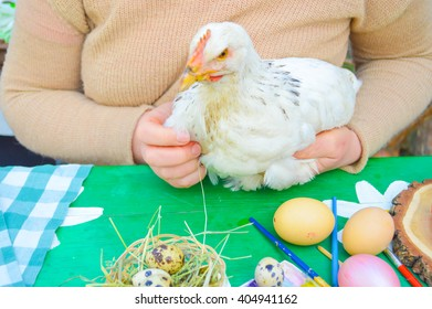 Easter composition.young woman holding a chicken.