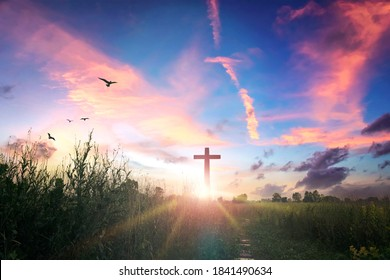 Easter concept: cross on sunset sky background