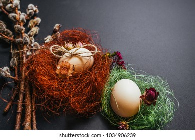 Easter concept, eggs, branches of the pussy willow on black background. Close-up. Free space. Easter set. Top view.
