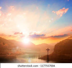 Easter concept: Silhouette cross on Calvary mountain sunset background