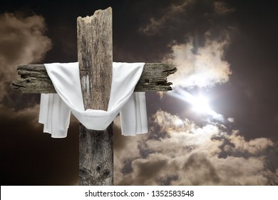 Easter cross on dramatic sky. He is risen concept.