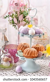 easter cupcakes on metal cakestand  with eggs and beautiful decorations  on festive table