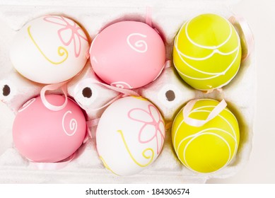 Easter decoration. Background with colorful eggs isolated on white with space for text.