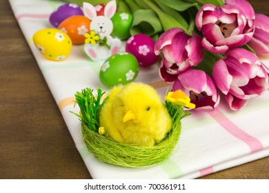 easter decoration with chick and tulips