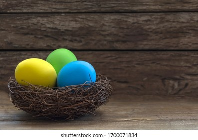 Easter decoration with colorful eggs and rustic background.