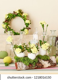 Easter decoration with egg shell, carnation flower, buxus, chamelaucium and moss. Home ideas.