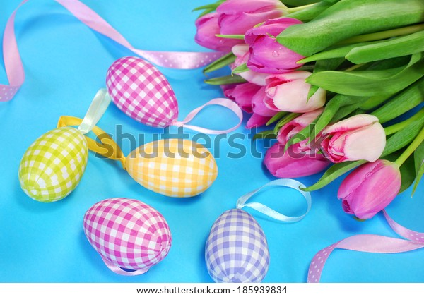 easter decoration with eggs and fresh tulips in pastel colors