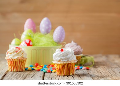Easter decoration with green grass,eggs and cupcakes